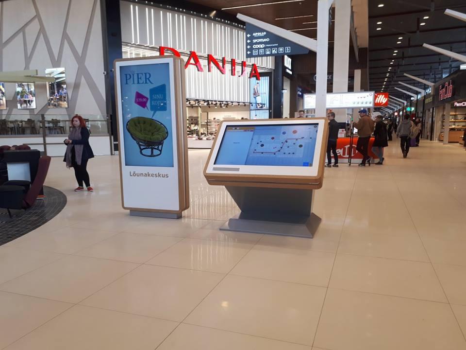 wayfinder kiosk near digital signage display